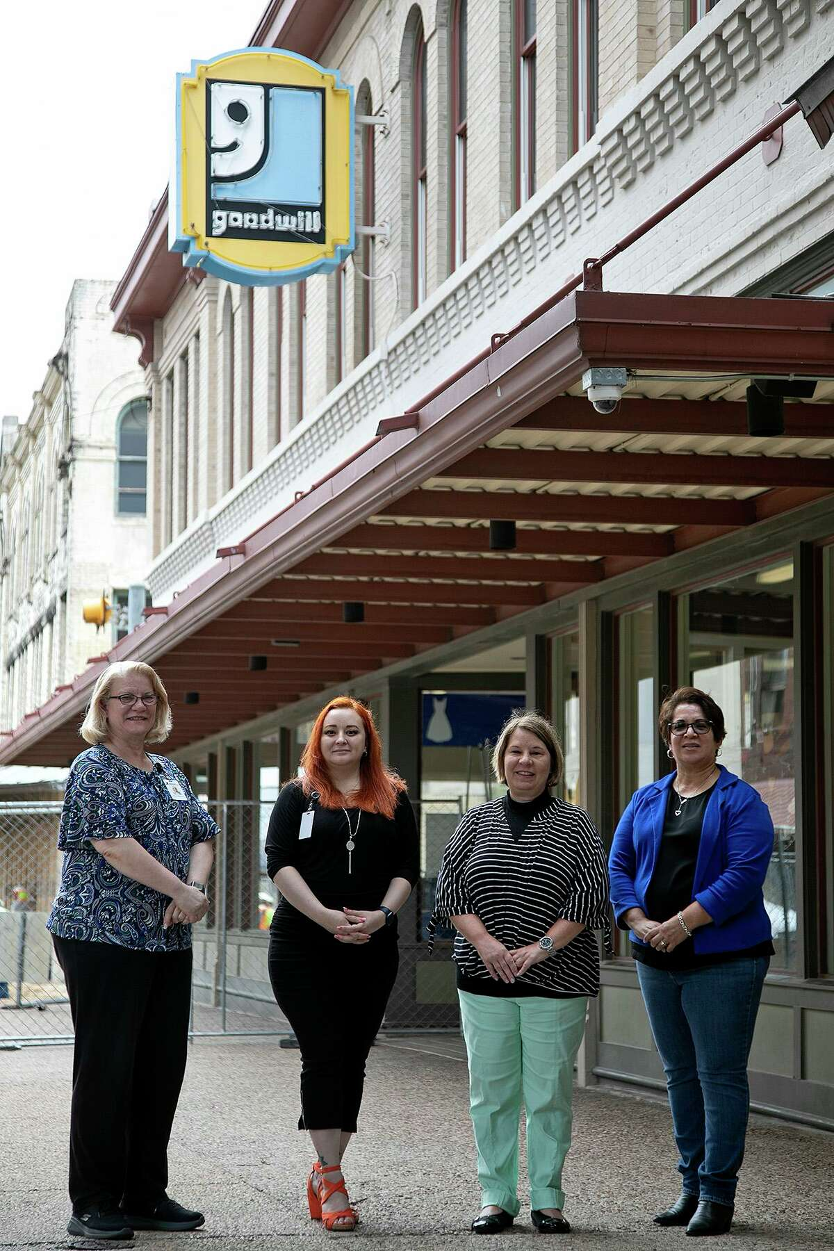 Employees Trina Hibbard, from left, Lauren Serrato, Janet Ward and Maria Z. Aguillon are shown outside Goodwill in downtown. Their workplace is just two blocks away from a siren whose source Aguillon long had wondered about.