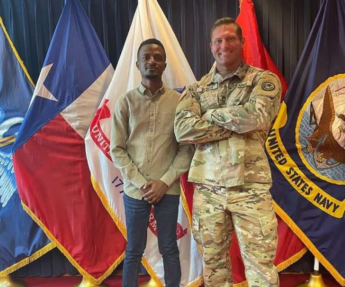 Sgt. First Class Jon DuBois welcomes a new cadet to the Texas Army National Guard on June 7, 2021.