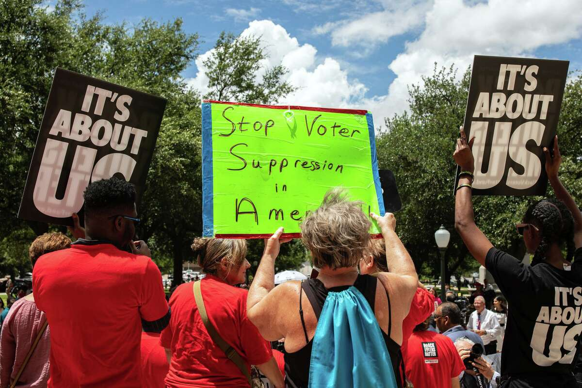 Voting rights advocates rally in Austin the first day of the Legislature's special session Thursday.