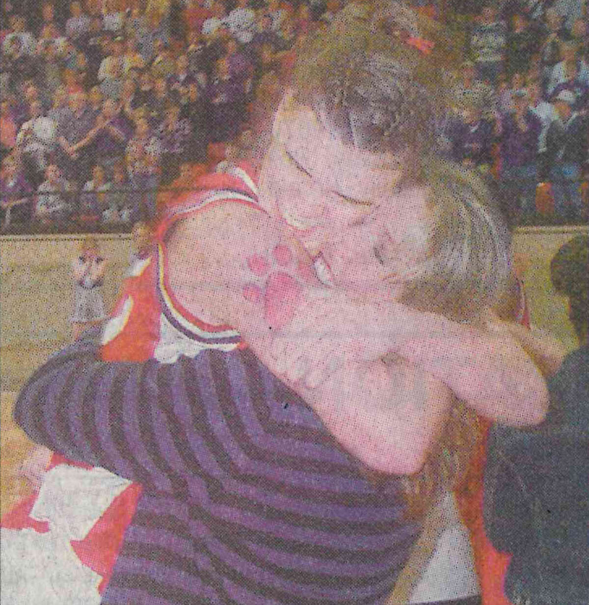 Stephanie Shaw and assistant coach Mandy Steen share a moment after beating Canyon in the 2001 region championship game.