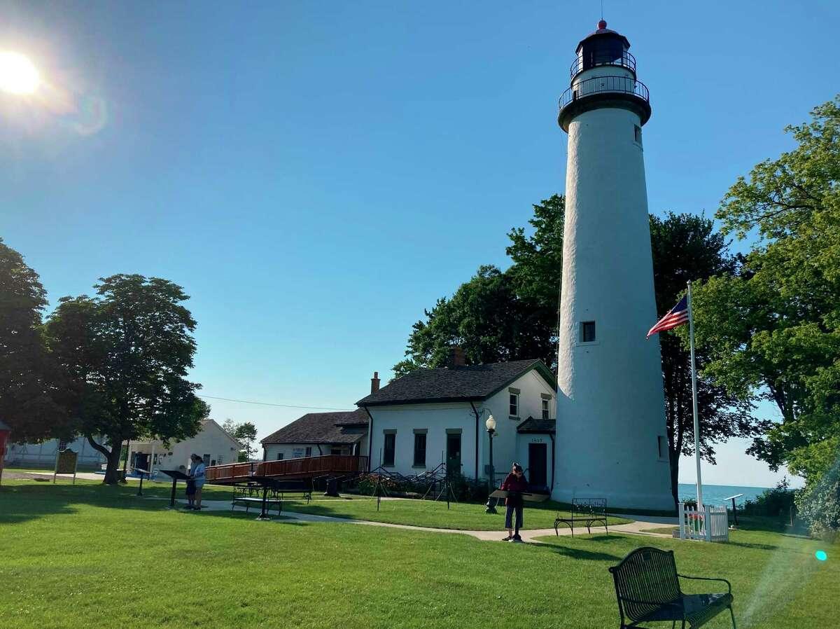 The Pointe Aux Barques Lighthouse sits peacefully alongside Lake Huron July 3. (Teresa Homsi/Huron Daily Tribune)