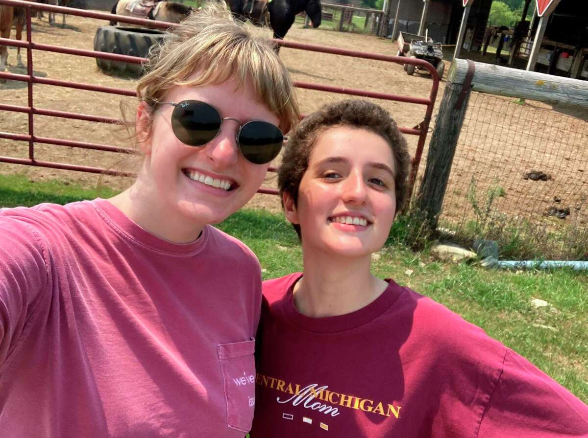 Sweaty but excited, my college roommate and friend, Maddie, and I pose for a photo after riding horses at Knoblock Riding Stable July 4. We didn't get any actual photos on horses, so this is the photo we've been sending people.(Teresa Homsi/Huron Daily Tribune)