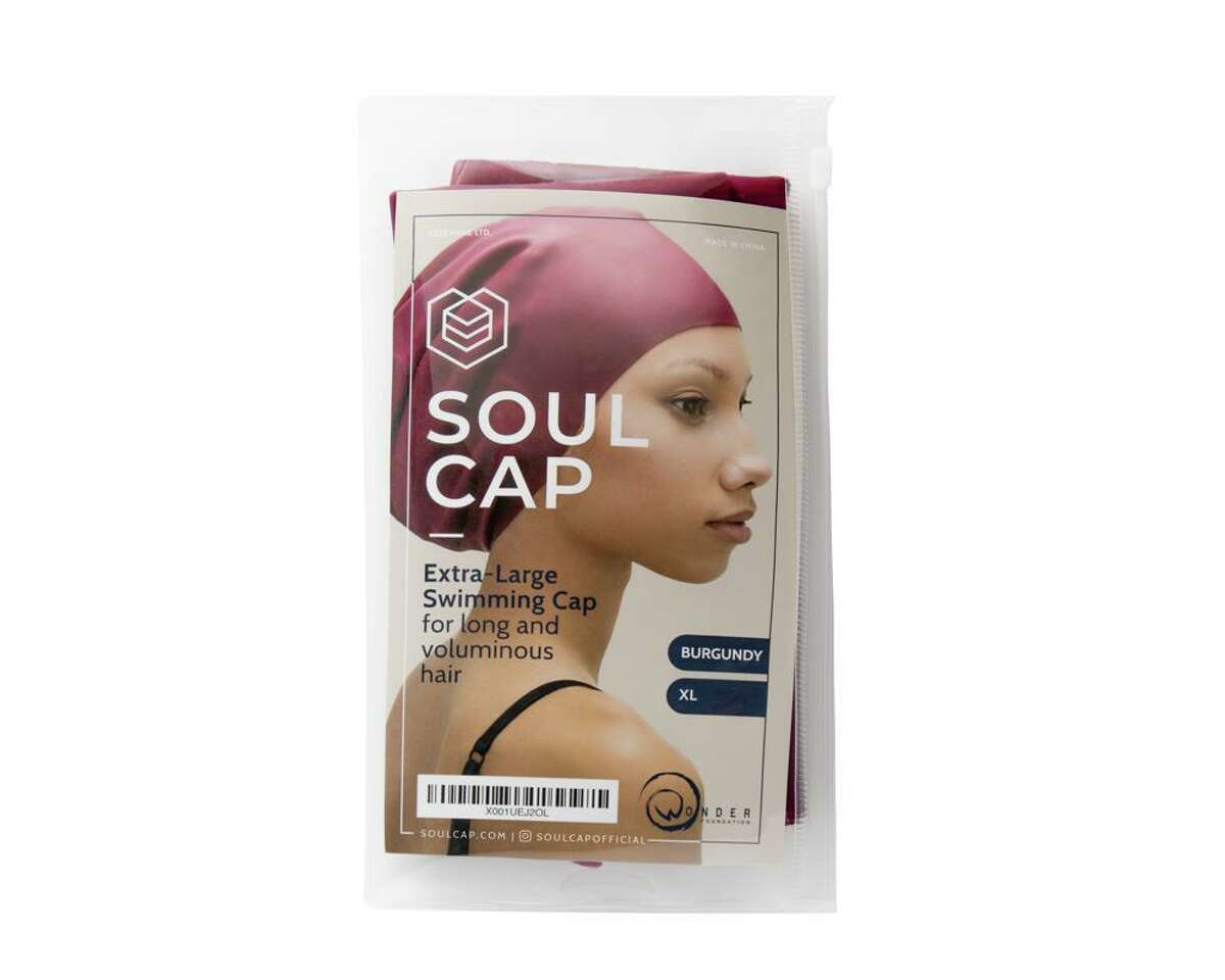 """JOY COL: The International Swimming Federation (FINA) says it is """"reviewing"""" its decision not to allow the use of swimming caps designed for natural Black hair at the Tokyo Olympics this summer.FINA drew heavy criticism after Soul Cap, a UK-based brand, announced that the governing body for aquatic sports refused to approve the caps designed for swimmers with """"thick, curly, and voluminous hair"""" in international competitions. The reason given was that their caps do not """"follow the natural form of the head,"""" Soul Cap told the BBC."""