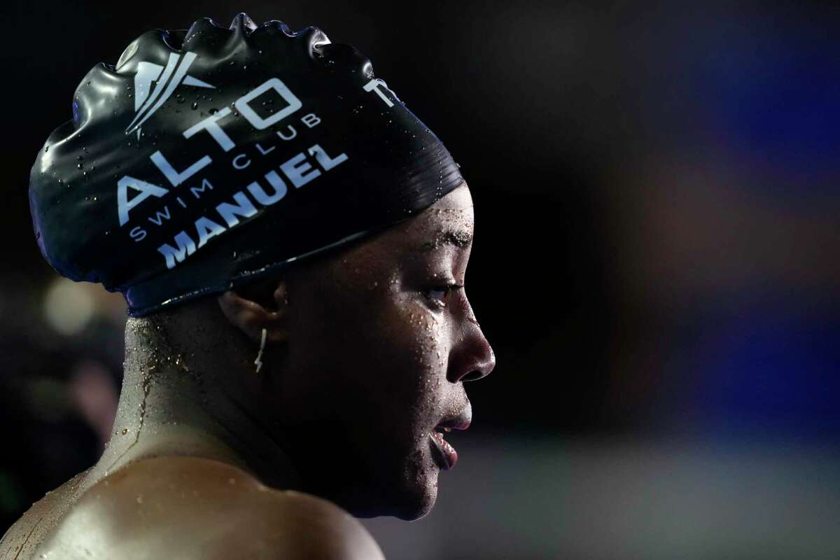 Simone Manuel is interviewed after winning the women's 50-meter freestyle final during wave 2 of the U.S. Olympic Swim Trials on Sunday, June 20, 2021, in Omaha, Neb. (AP Photo/Charlie Neibergall)
