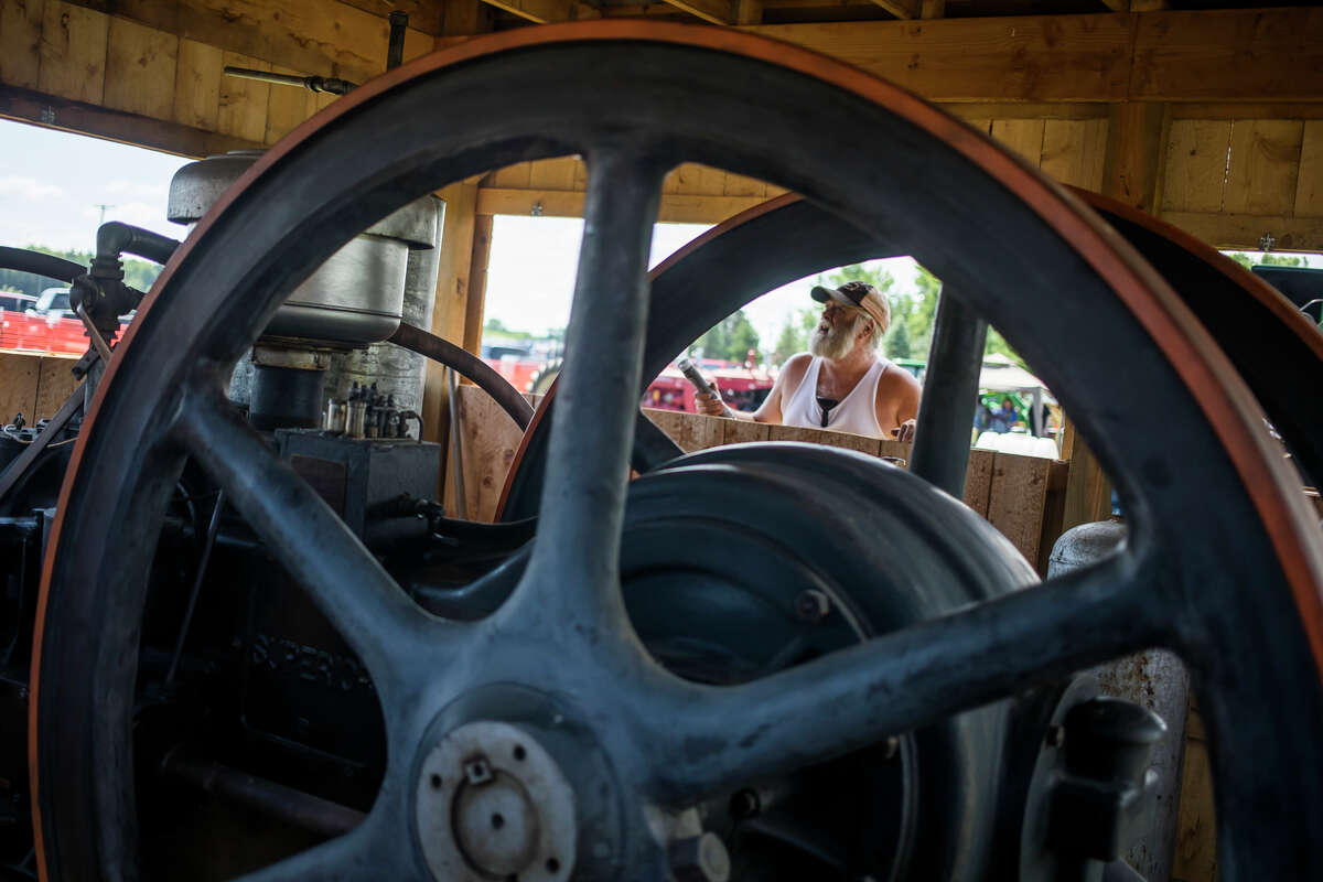 Engine enthusiasts gather for the first day of the 33rd Annual Midland Antique Engine Association Tractor Show Friday, July 9, 2021 at 3226 S. Meridian Rd. in Merrill. (Katy Kildee/kkildee@mdn.net)