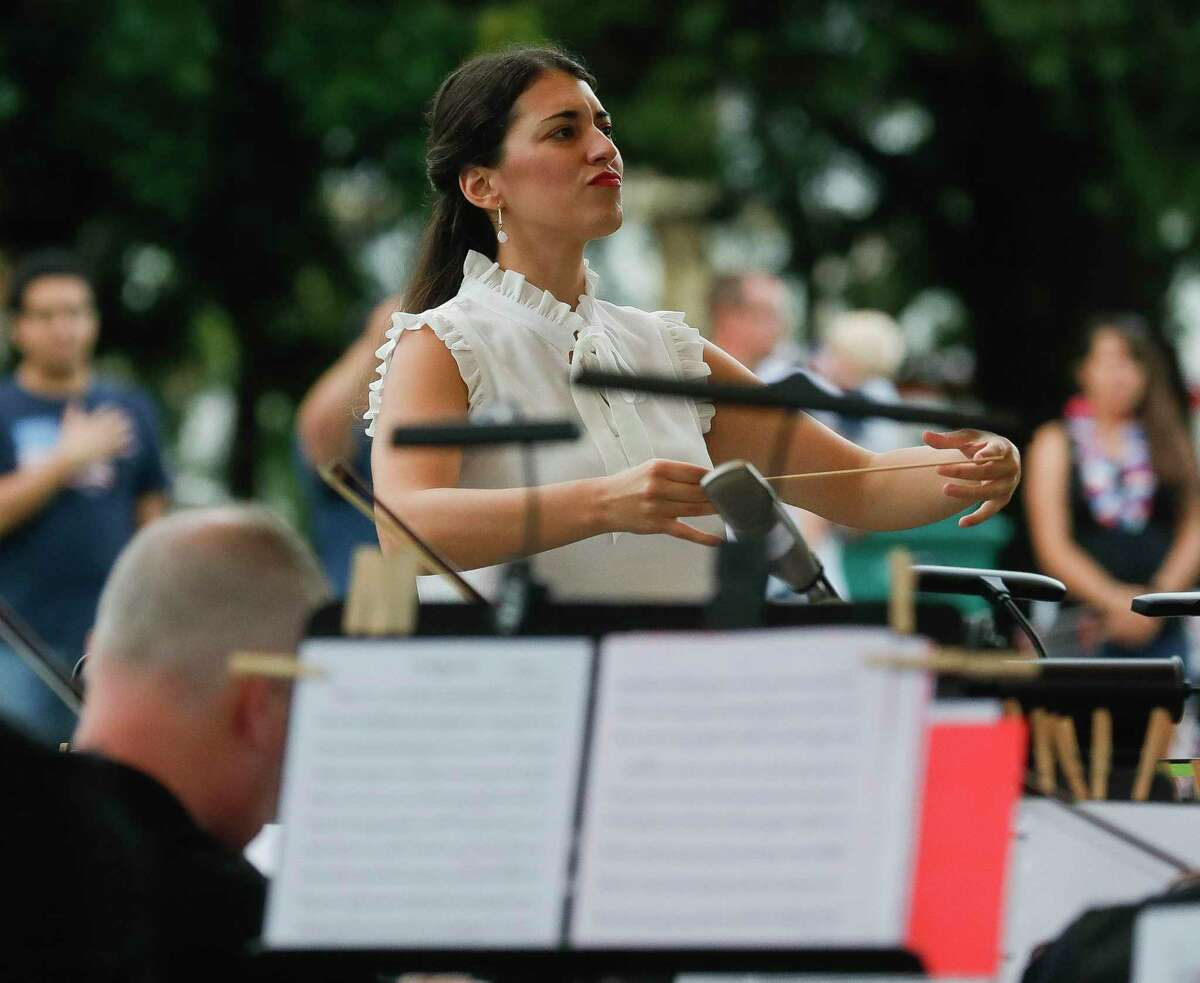 New Music Director Anna-Maria Gkouni leads the Conroe Symphony during a concert at Heritage Place Park, Saturday, July 3, 2021, in Conroe.