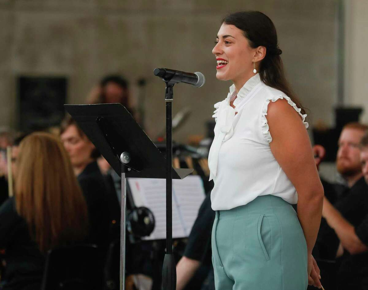 New Music Director Anna-Maria Gkouni speaks before leading the Conroe Symphony at Heritage Place Park, Saturday, July 3, 2021, in Conroe.
