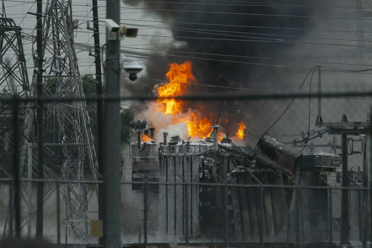 A fire burns at a CenterPoint Energy substation west of Brittmore Road at Kempwood Drive on Friday, July 9, 2021, in Houston.
