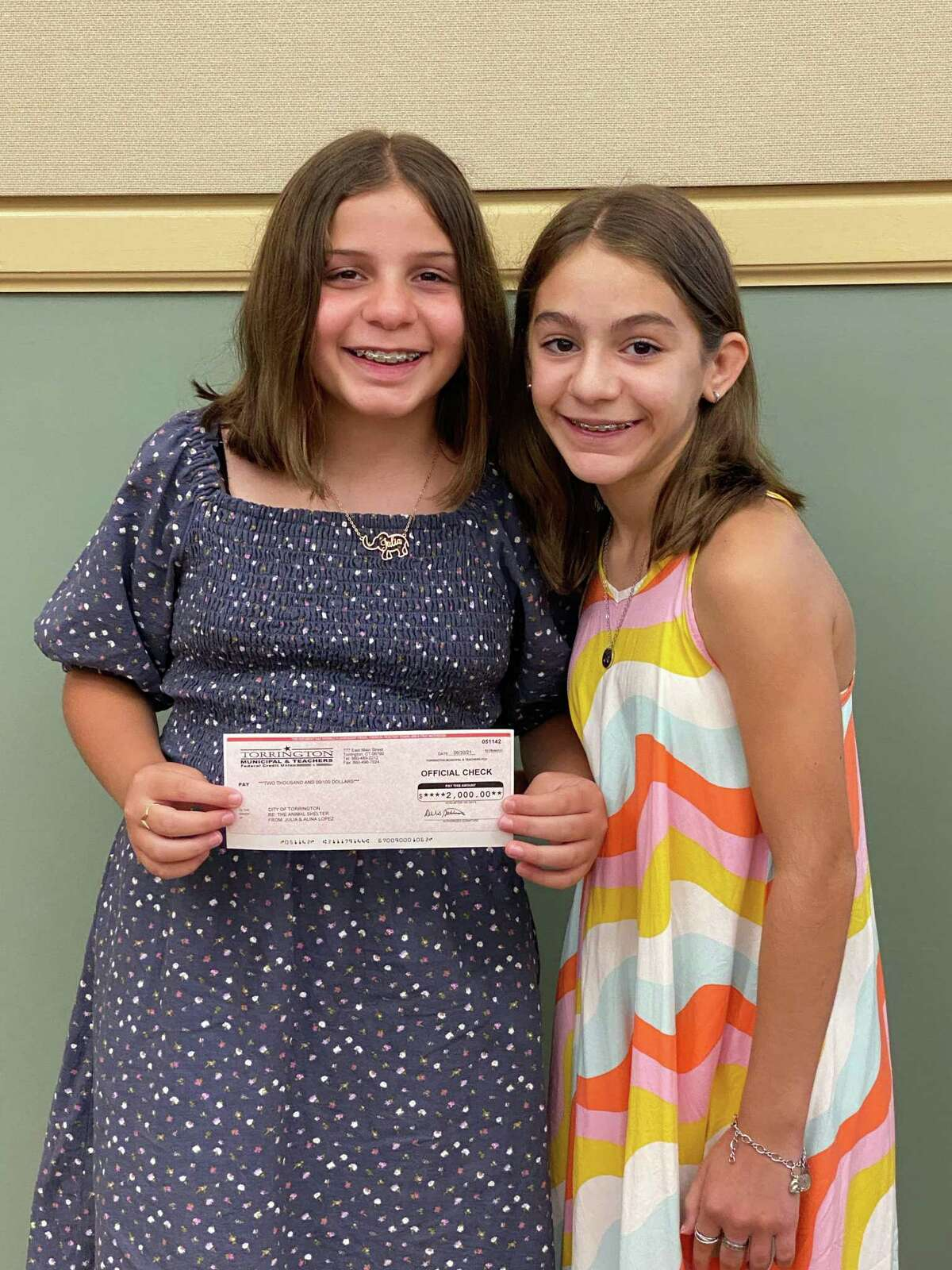 Julia Lopez, 11, left, and her sister Alina, 13, made a donation of $2,000 to the city's animal shelter project July 7 during the Board of Public Safety meeting. Julia raised the money by selling baked goods, tabouli and hummus, and, later, the sisters baked dog treats.