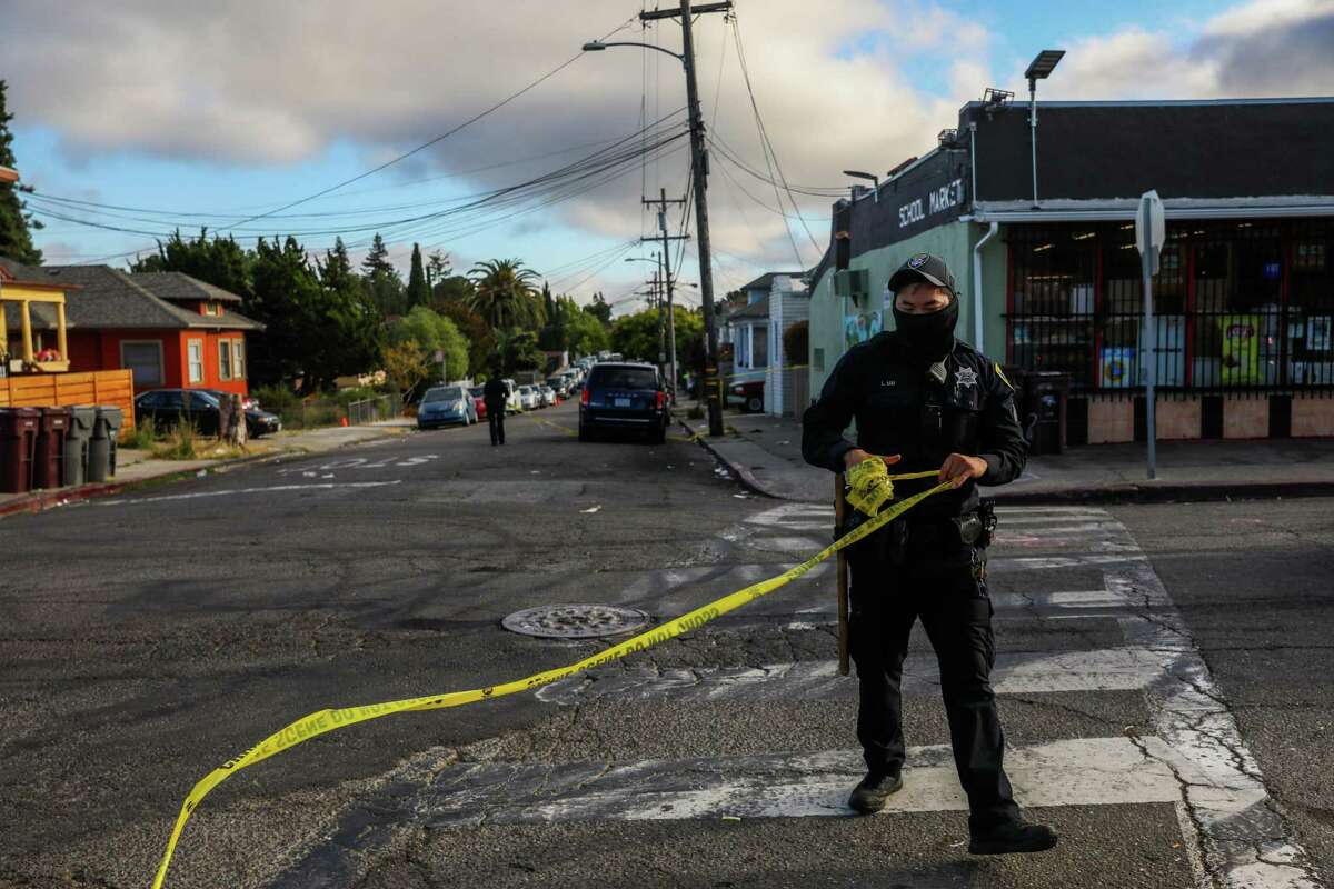 Oakland police Officer L. Mai collects crime tape after a shooting investigation in June. California officials recently released data showing that homicides in the state were up 31% in 2020. But the reasons for the spike - the largest percentage increase in years - are still unclear.