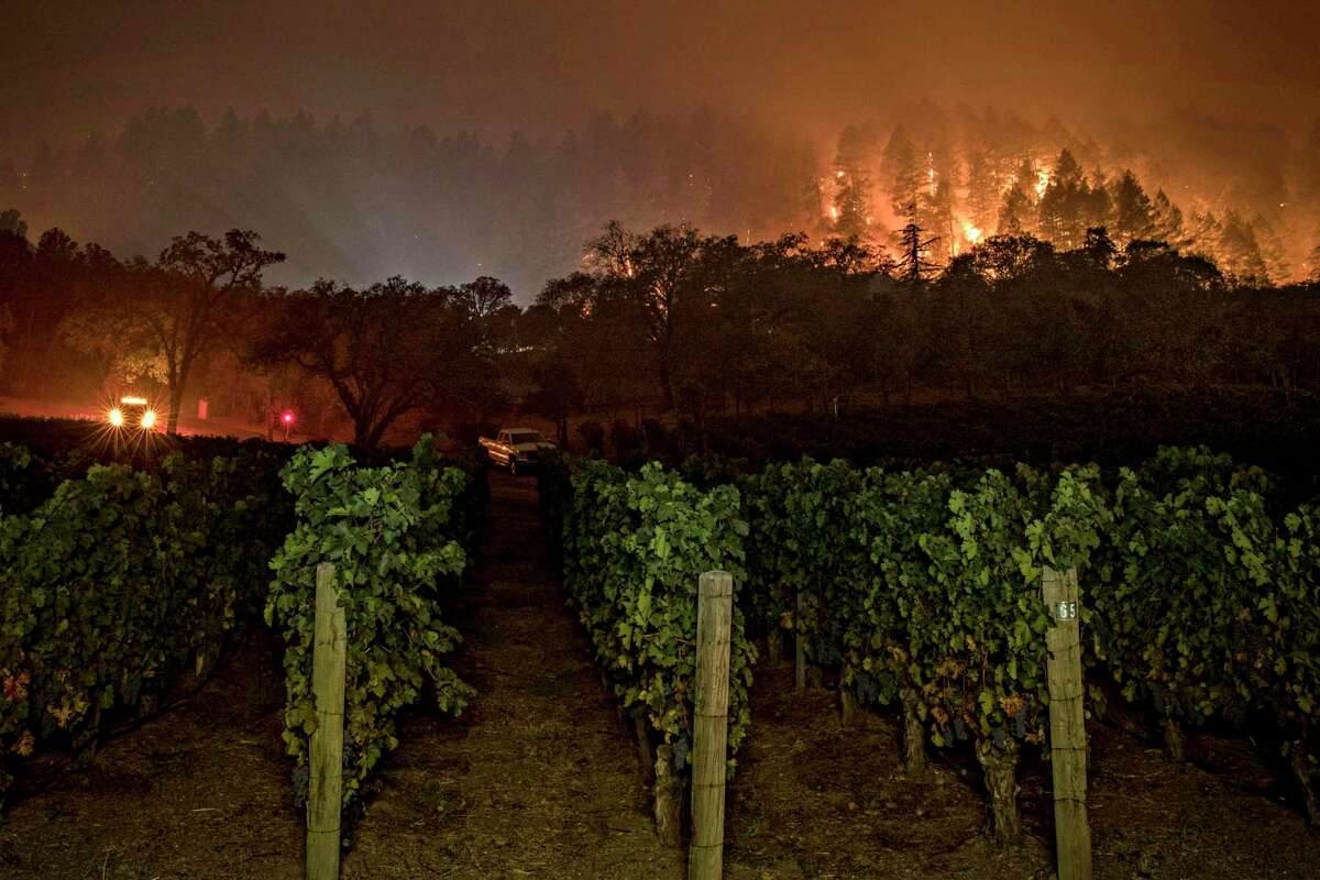 A fire crew kept watch at Vineyard 29 as a slow-moving section of the Glass Fire burned between St. Helena and Calistoga on Sept. 28.