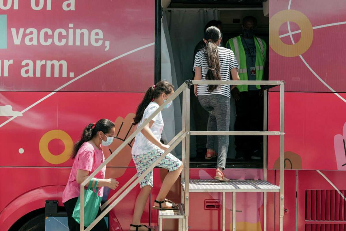A family enters a pop-up COVID-19 vaccine site on June 5, 2021 in the Jackson Heights neighborhood in the Queens borough in New York City. (Scott Heins/Getty Images/TNS)