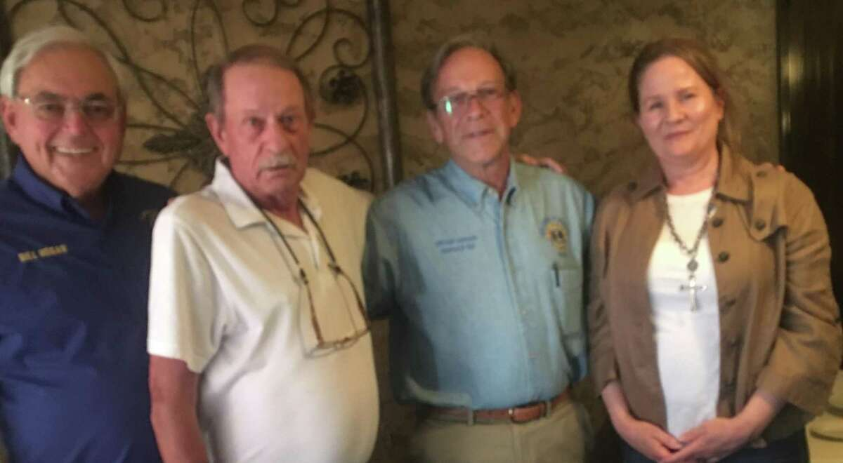 Lake Conroe Centennial LIons Club installed two new members to the club. Shown here with LCCLC President Bill Hogan (on left) and Past District Governor Karl John (third from left) with new Lions Clyde McDowell and Pennie Deligans.