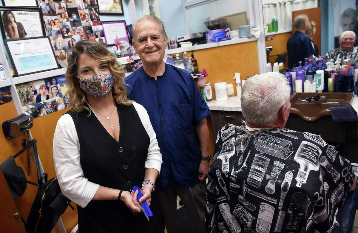 Kathy Moura, left, is photographed with Pio Imperati at Pio of Italy Hair Studio on Whalley Avenue in New Haven on June 29, 2021. At right is longtime customer Arnie Mann.