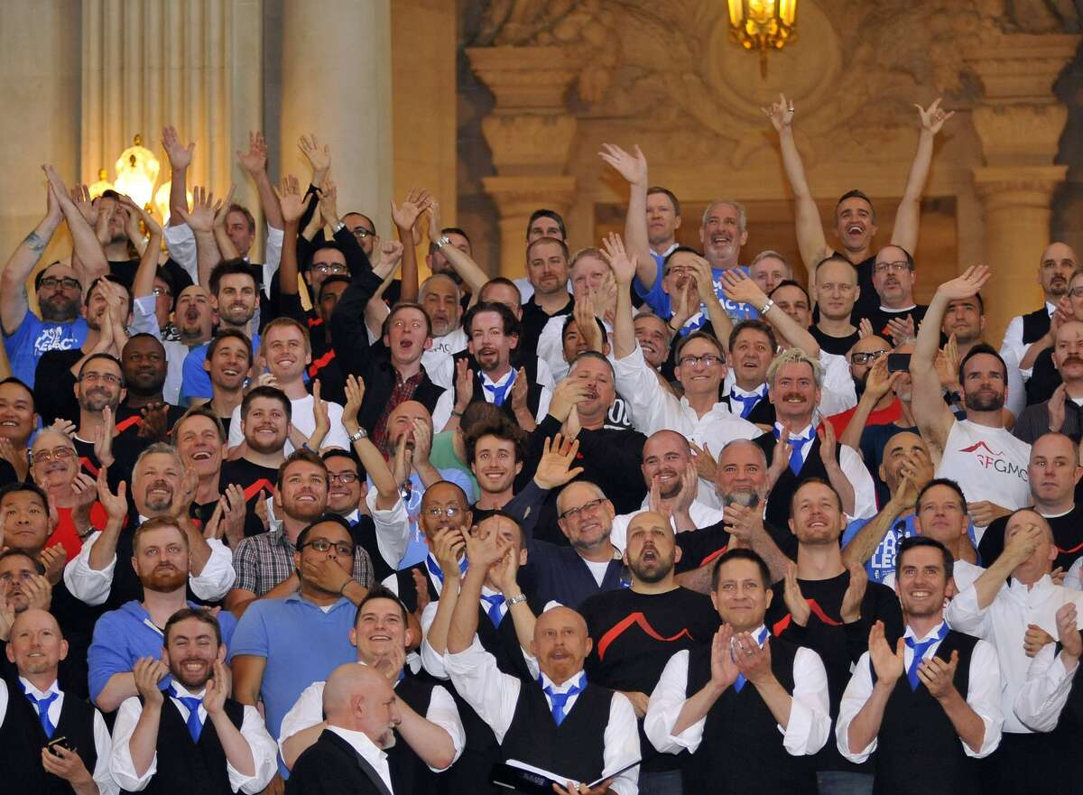 The San Francisco Gay Men's Chorus cheer for same-sex couples as they get married, one couple after another, at San Francisco City Hall in California on Friday, June 28, 2013.