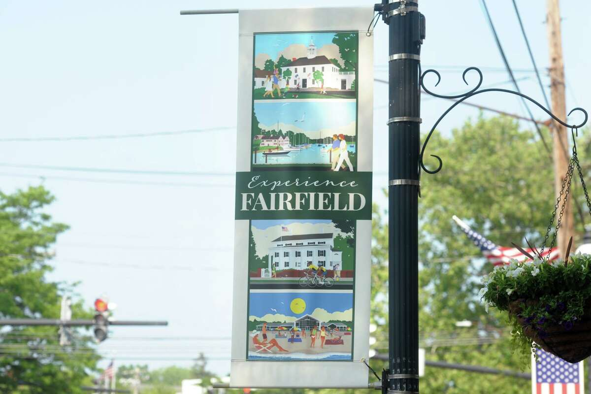 Banners with the work of artist Paul Siegel's Experience Fairfield commemorative poster series hang along Boston Post Road in Fairfield on Wednesday.