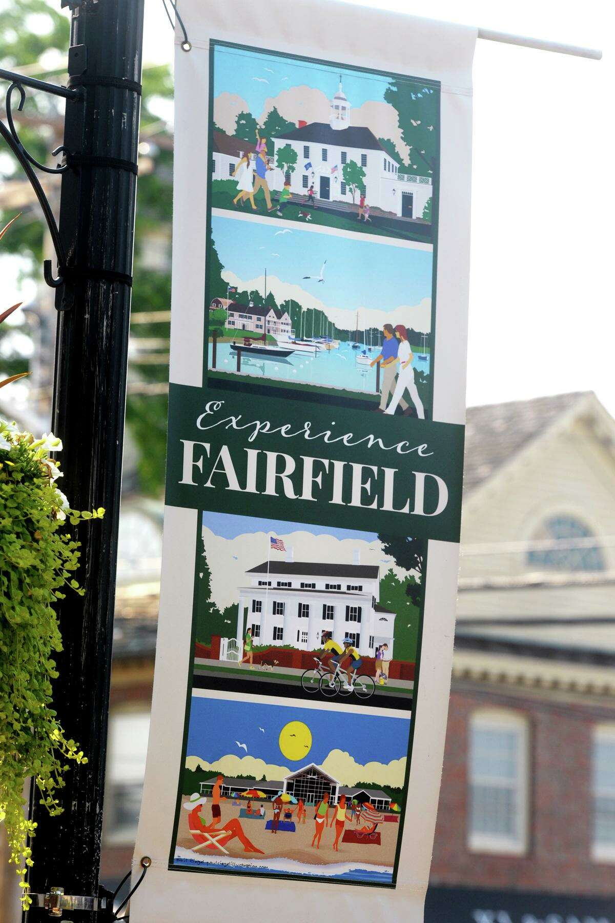 Banners with work from artist Paul Siegel's Experience Fairfield commemorative poster series hang along Boston Post Road in Fairfield on Wednesday.