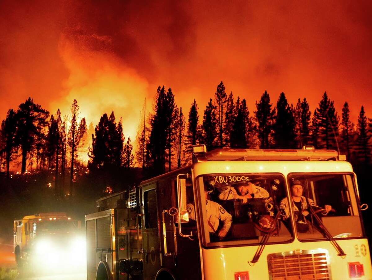 Firefighters arrive Thursday to battle the Sugar Fire, part of the Beckwourth Complex Fire, burning in the Plumas National Forest north of Truckee. Containment is dropping.