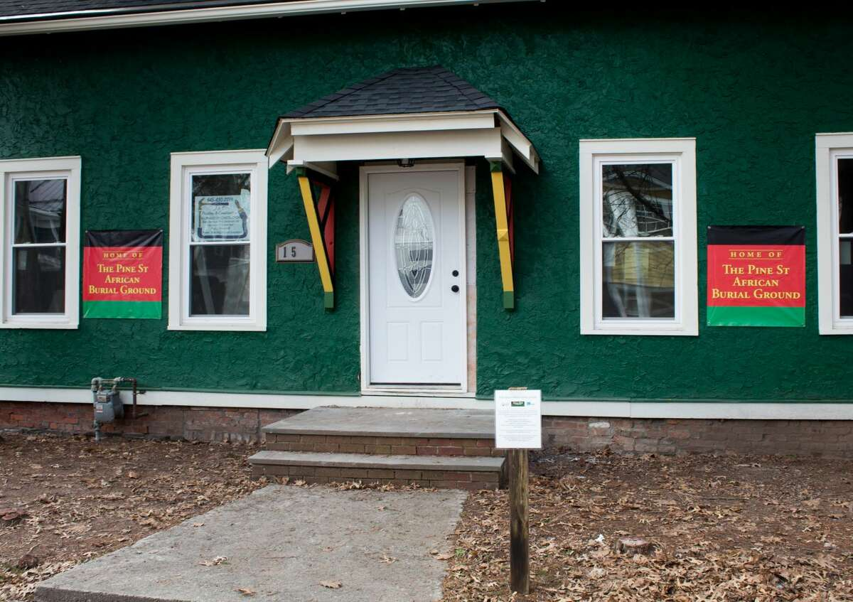 The building at the center of the Kingston burial site has already undergone some renovations to turn it into a multi-purpose space for the community. A timeline painted on the interior walls tells the history of the burial site, dating back to the 1750s.