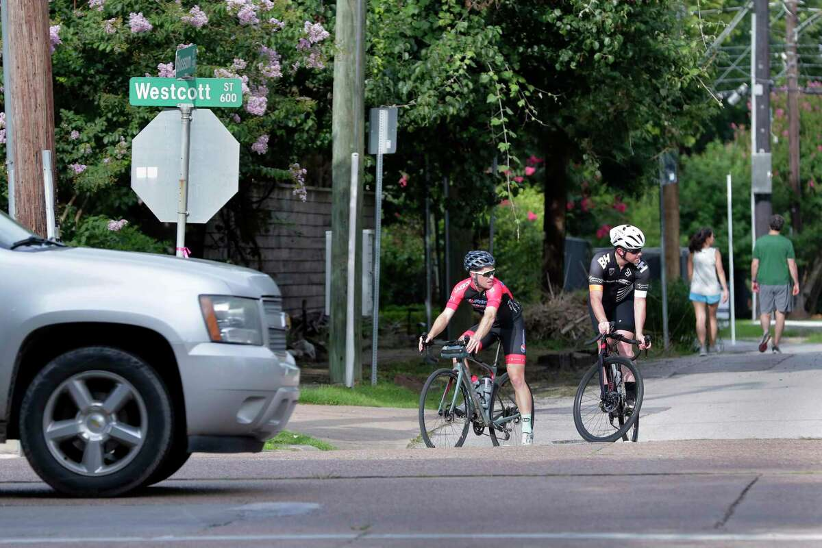 Cyclists wait for a break in traffic as they attempt to cross Westcott on Blossom, near Memorial Park on July 7, 2021. Memorial Park is seeing improvements, but the access areas around the park for those who use it have not seen many improvements.