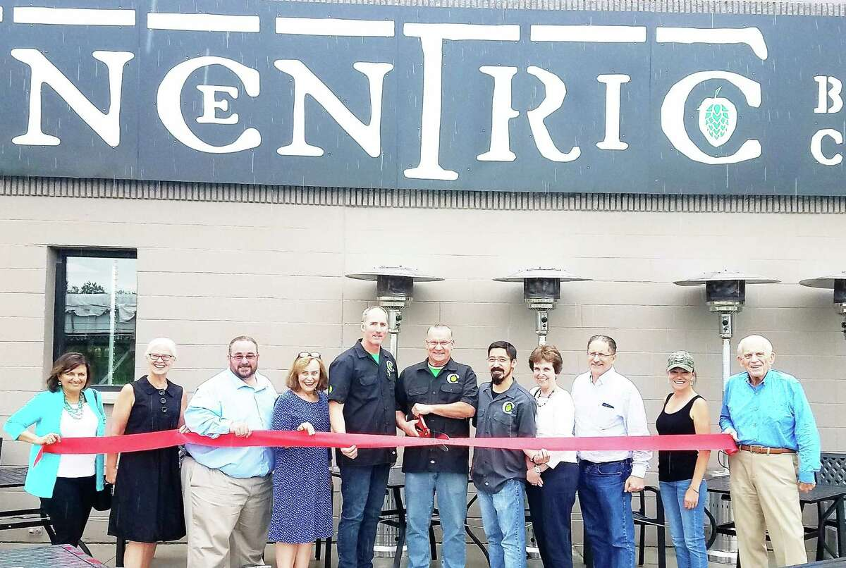 Concentric Brewing Company in Portland marked its grand opening July 1. From left are residents Berneise Zampano and Kitch Czernicki, Selectman Jim Tripp, Selectwoman Susan Branfield, co-owner and assistant brewer Drew France, co-owner David Peichert, head brewer Brian Aida, Middlesex County Chamber of Commerce Chairwoman Maureen Westbrook, Selectman Ralph Zampano, Chamber Vice President Johanna Bond and President Larry McHugh.