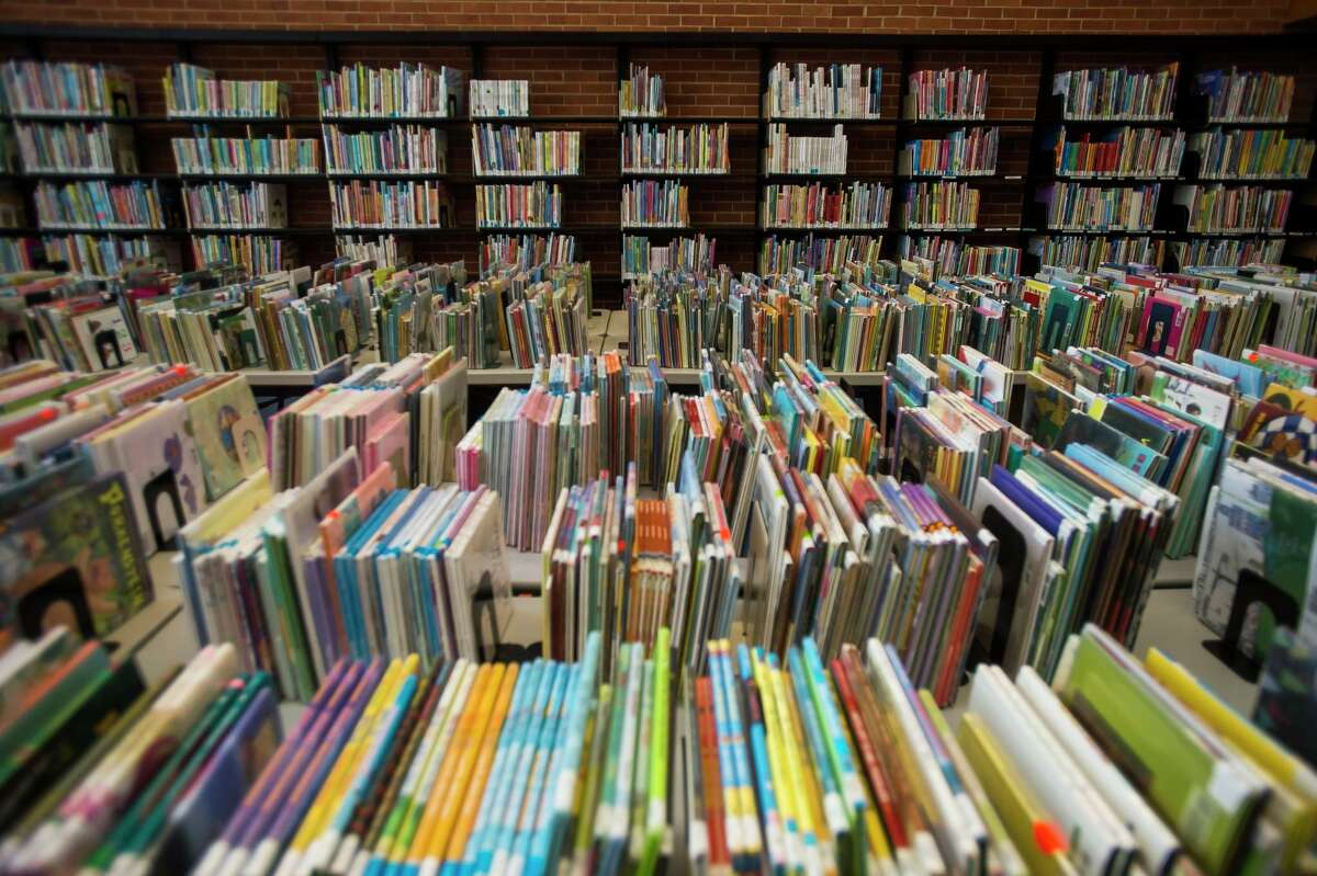 Books are staked in the library's Quiet Room following the May 2020 mid-Michigan dam failures. The library opens to the public for the first time since COVID-19 on Monday. (File photo/Midland Daily News)