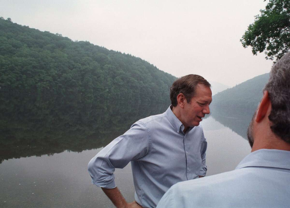 Times Union Staff Photo by PAUL BUCKOWSKI Governor George Pataki, LEFT, stands on the banks of the Hudson River at the Spier Falls boat launch, after a press conference in which it was announced an expansion of land to the Moreau Lake State Park\ in 1998. Pataki's goal in the late 1990s was to close all of the Adirondack dumps.