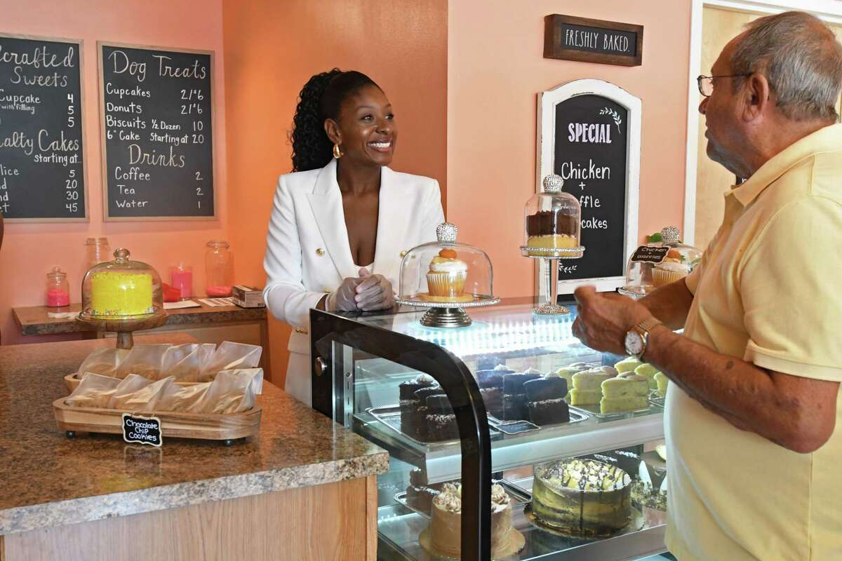 Owner Renel Turner serves Gil Ethier, her first customer, during a grand opening of Nelly's Treats, a new bakery that offers treats for dogs and humans alike on Friday, July 9, 2021 in Cohoes, N.Y. (Lori Van Buren/Times Union)