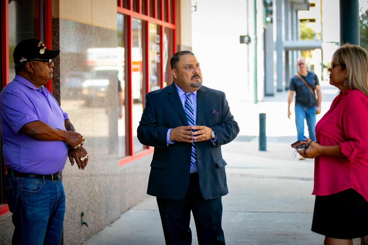 Adrian Carrasco talks with constituents after announcing his candidacy for Midland College Board of Trustees in August.