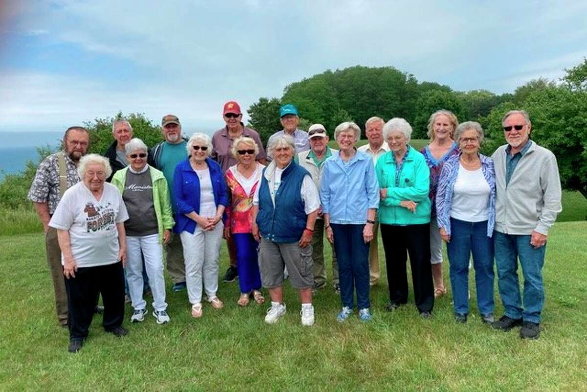 """TheManistee High Schoolclass of 1960 met on June 27 for its annual """"twins"""" picnic. Pictured (front row, left to right) areKathe Cook Goffar, Ann Johnson Powell, Karen Courtney Kubanek, Kathie Bjorkquist Bernaciak, Phyllis Thorsen, Jeanne Fredrickson Youngberg, Sandy Tremblay Cabot, Marti Hanson Somsel, Don Pelarski; (back row) Dave Neitzke, Bill Engwall, Doug Coombs, Jeff Johnson, Paul Bosschem, Larry Caro, Ken Ekholm and Linda Andresen. Also attending but not pictured was Mary Esther Marshall. (Courtesy photo)"""