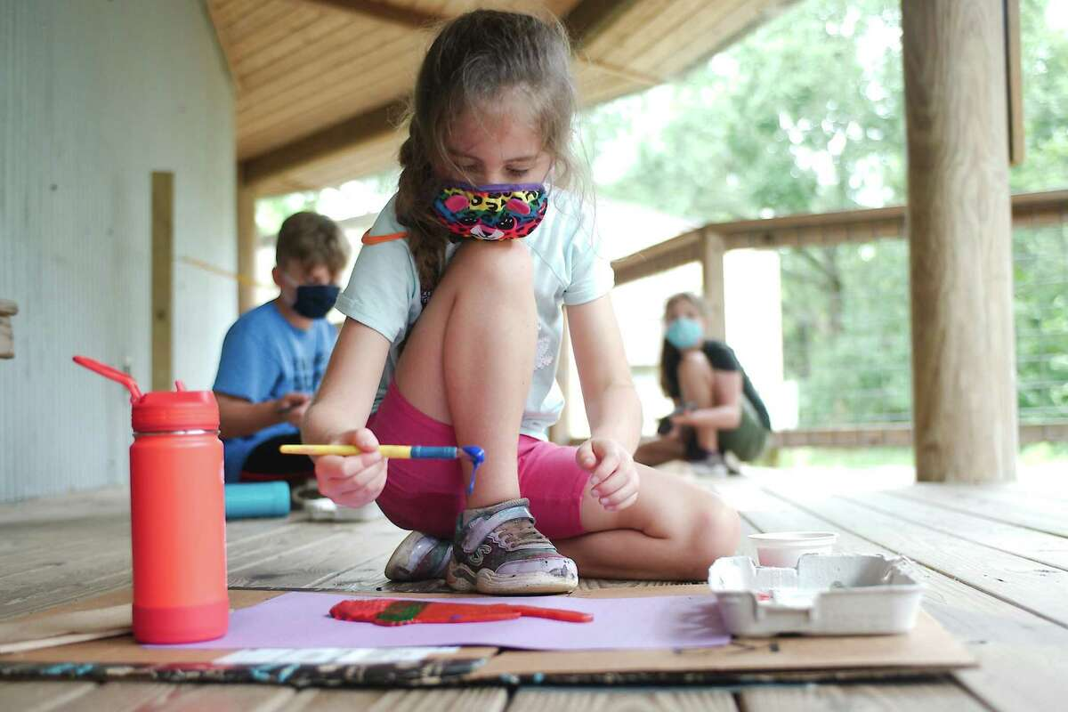 Rosalind Prentice, Elliot Prentice and Sydney Bergman create Gyotako fish prints at Armand Bayou Nature Center summer camp. The camps have been packed and attendance is up at the center.