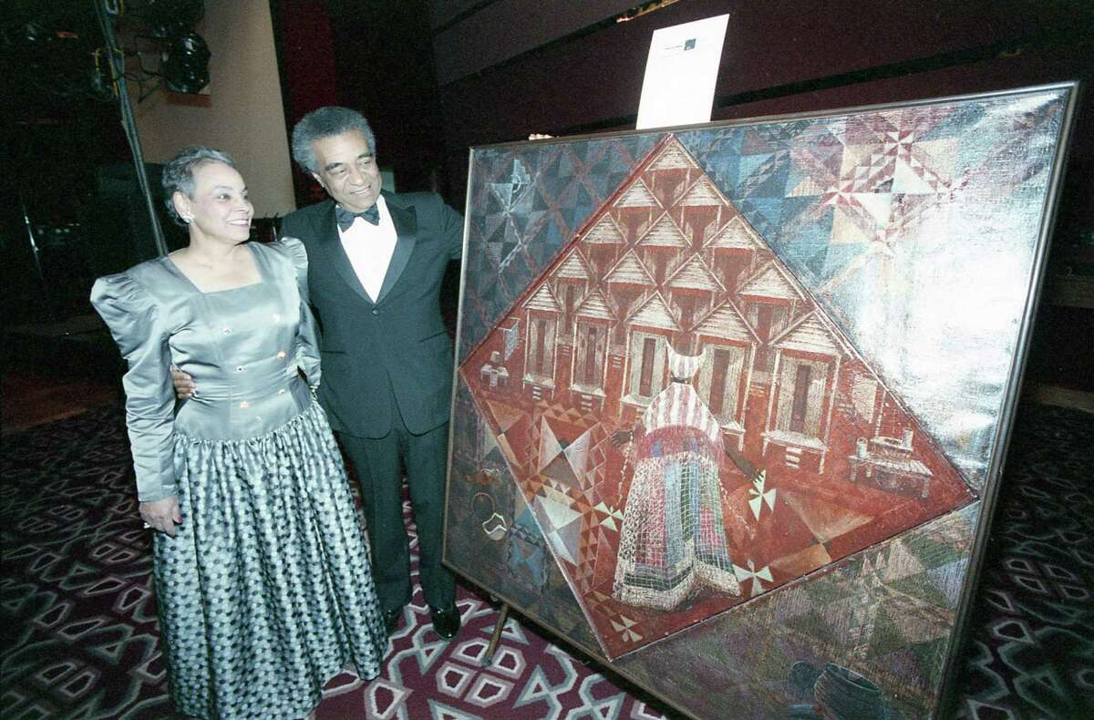 Artist John Biggers and wife, Hazel, at a dinner at the Hyatt Regency where he was named Texas Artist of the Year for 1988 by the Art League of Houston, March 12, 1988.