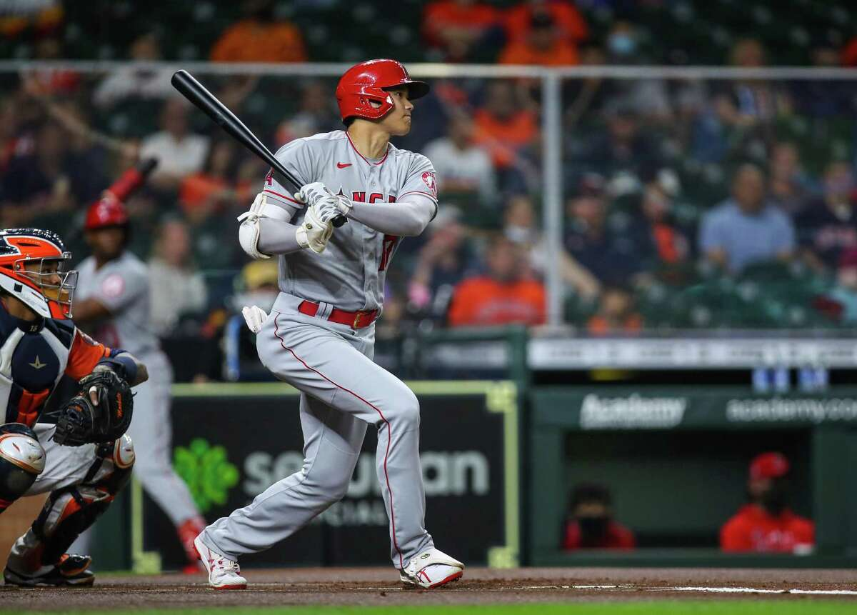 Los Angeles Angels designated hitter Shohei Ohtani (17) hits a single against the Houston Astros during the first inning of an MLB game at Minute Maid Park on Friday, April 23, 2021, in Houston.