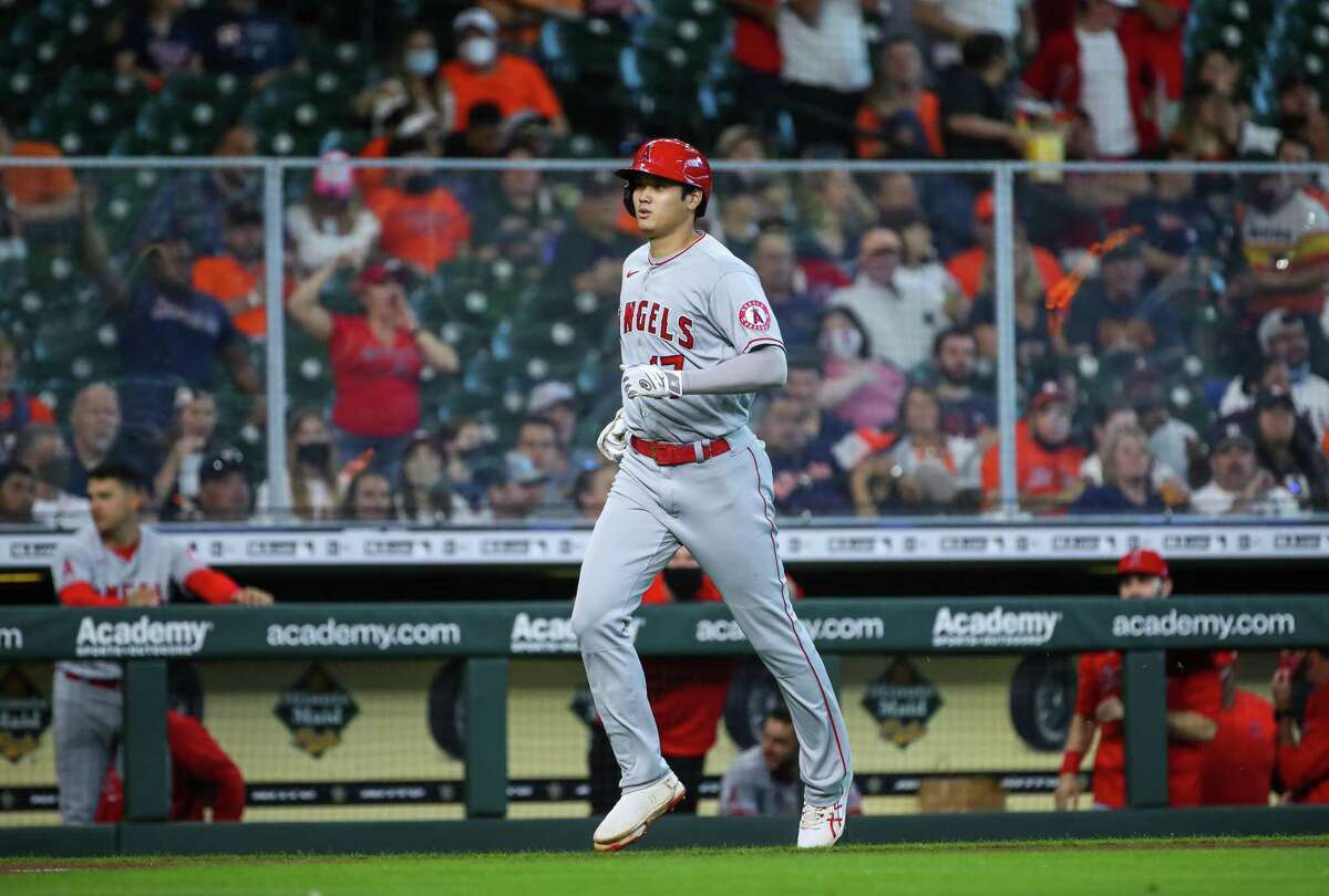 Los Angeles Angels designated hitter Shohei Ohtani (17) hits a solo home run against the Houston Astros during the third inning of an MLB game at Minute Maid Park on Saturday, April 24, 2021, in Houston.