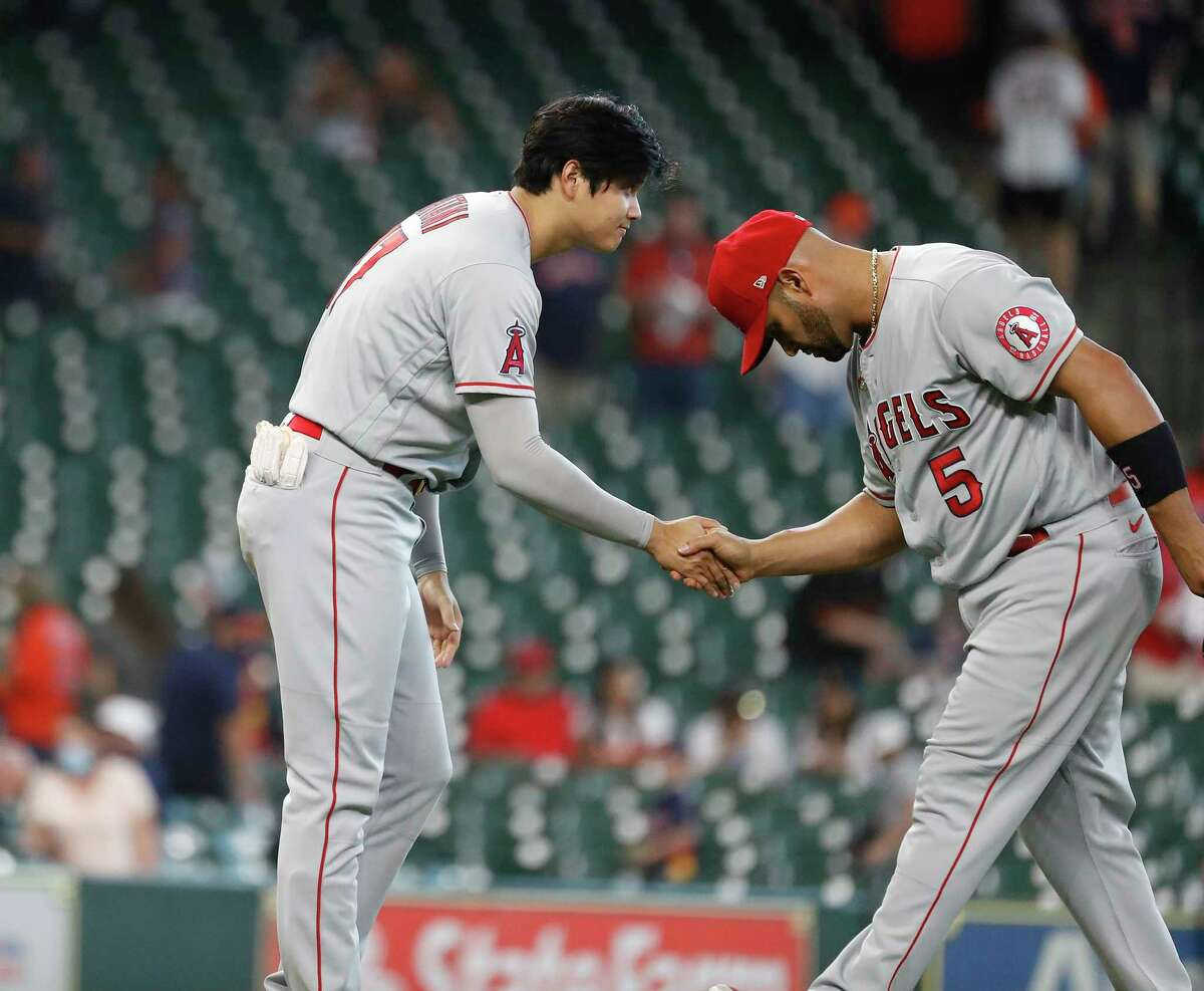 Los Angeles Angels Shohei Ohtani (17) congratulates Los Albert Pujols (5) after beating the Houston Astros 4-2 after an MLB baseball game at Minute Maid Park, Sunday, April 25, 2021, in Houston.