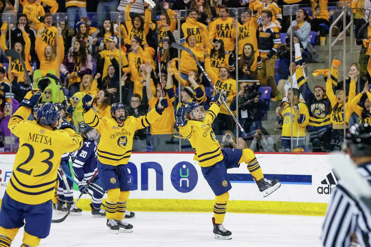 Quinnipiac players celebrate during the Bobcats win over Yale on Saturday night.