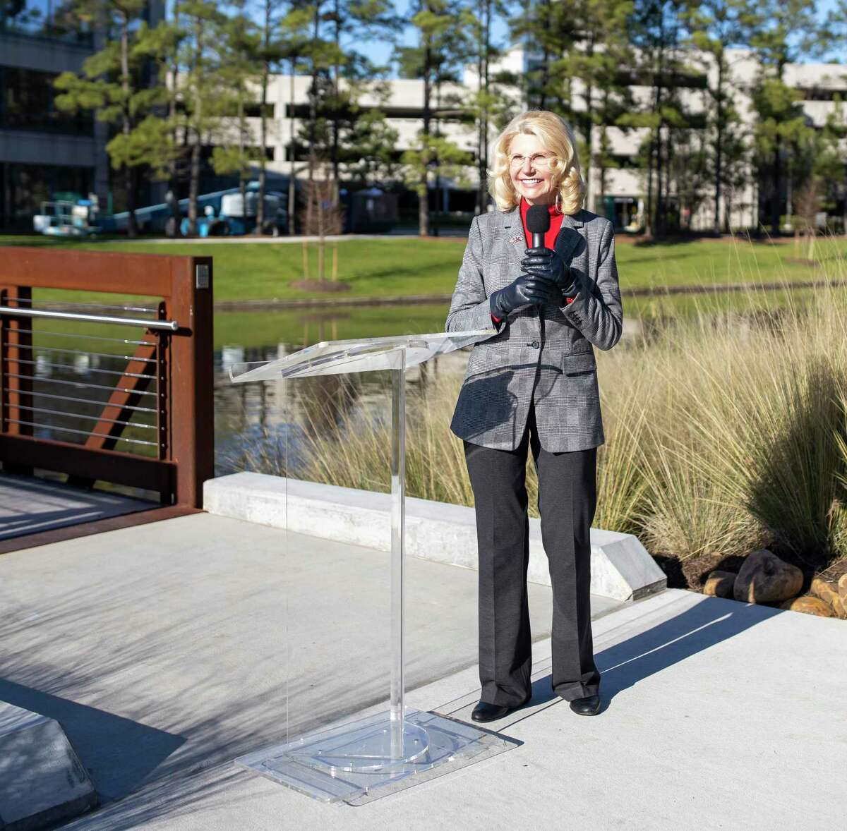 Dr. Shelley Sekula-Gibbs speaks during the ribbon cutting of the new pedestrian bridge located at Lake Front North in Hughes Landing was revealed on Friday, Jan. 24, 2020. Sekula-Gibbs announced she will seek re-election in the Nov. 2 township election.