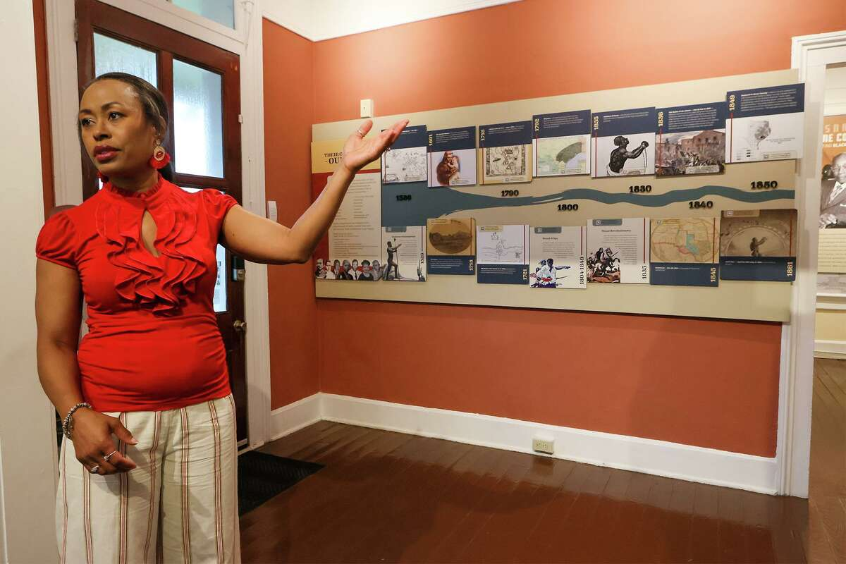 Program director Heather Williams talks about a timeline display on the wall showing contributions by African Americans to the region's history at the new home of the San Antonio African American Community Archive and Museum (SAAACAM) in the Southwest corner of La Villita Historic Arts Village at 218 A. Presa on Friday, July 9, 2021. The museum has a timeline display, archives and exhibits about local Black history and leaders who have worked for civil rights progress.