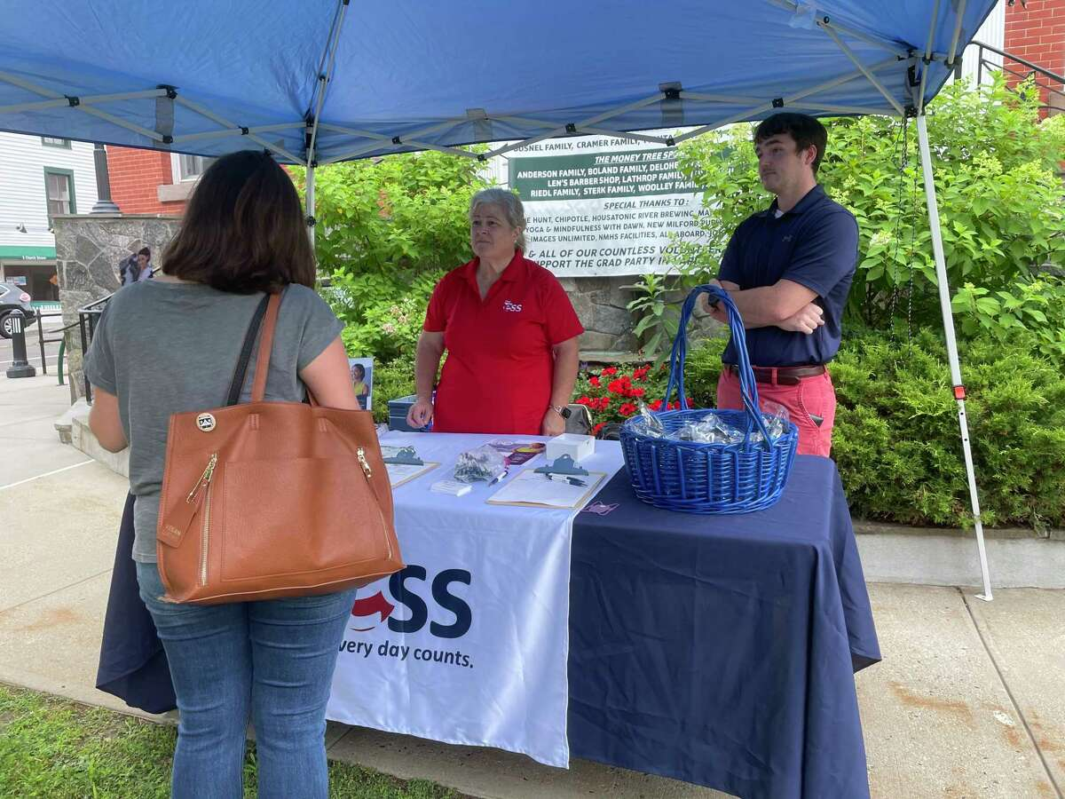 ESS, an education staffing company, has partnered with the town of New Milford to host a job fair with the hopes of increasing its substitute staff in the local school district for the upcoming school year. During the event, Rebecca McGee, 21, visits the tent to learn more about her options.