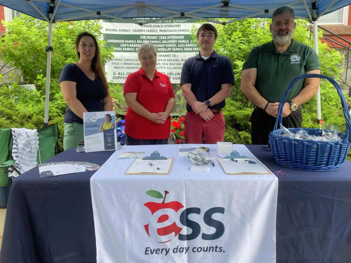 ESS, an education staffing company, has partnered with the town of New Milford to host a job fair with the hopes of increasing its substitute staff in the local school district for the upcoming school year. Pictured from right to left: ESS district manager Lisa O'Neill, regional manager Beth Salaris, district manager Dan Diamond, and Mayor Pete Bass.