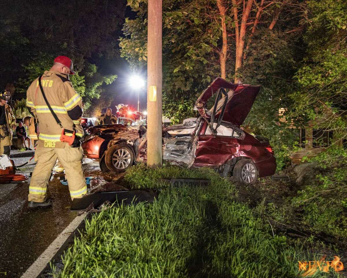 First responders at the scene of a Route 39 crash in New Fairfield, Conn., that seriously injured a 17-year-old driver the evening of June 14, 2021.