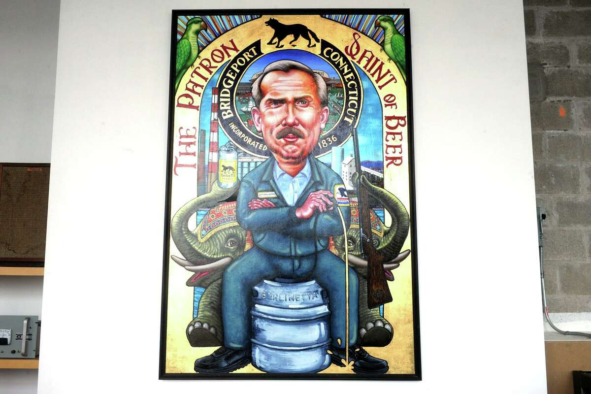 A painting of Bridgeport native John Ratzenberger, in his famous roll as Cliff Clavin, hangs in Berlinetta Brewing Company, in downtown Bridgeport, Conn. July 8, 2021.