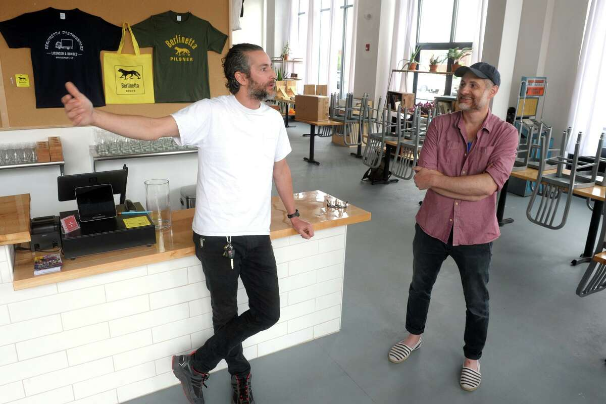 Brothers Rich and Chris Ruggiero speak during an interview at Berlinetta Brewing Co., their new brewery in downtown Bridgeport on Thursday.