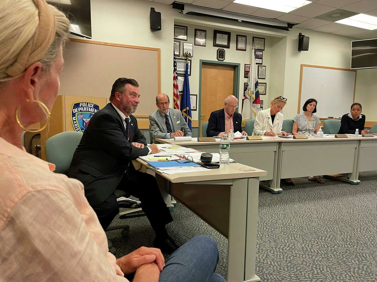 """The Madison Police Commission listened to residents' concerns about local car thefts at its July 8 meeting. Second from left is Madison Police Chief John """"Jack"""" Drumm."""