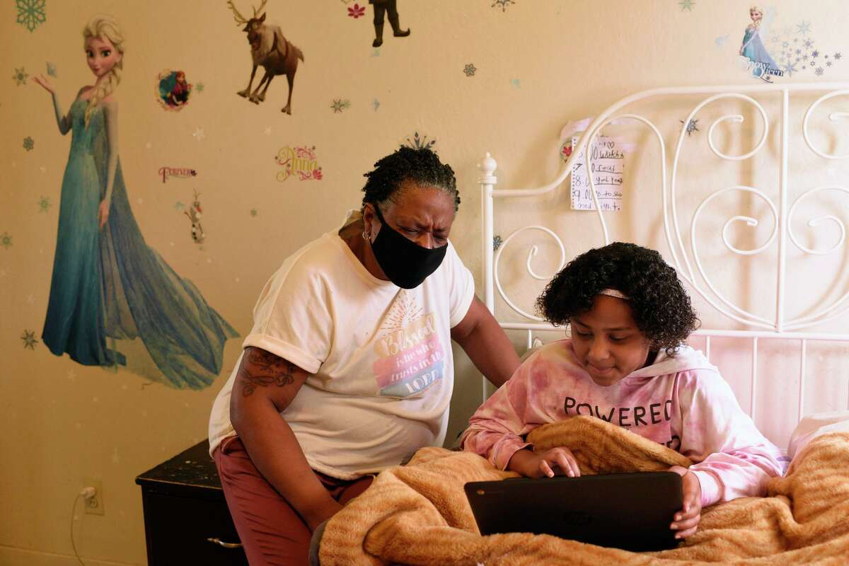 Rodeo resident Felicia Carter, shown helping her granddaughter, Daeshanay Gospel, 9, with remote schoolwork, had her unemployment benefits inexplicably stop in December.
