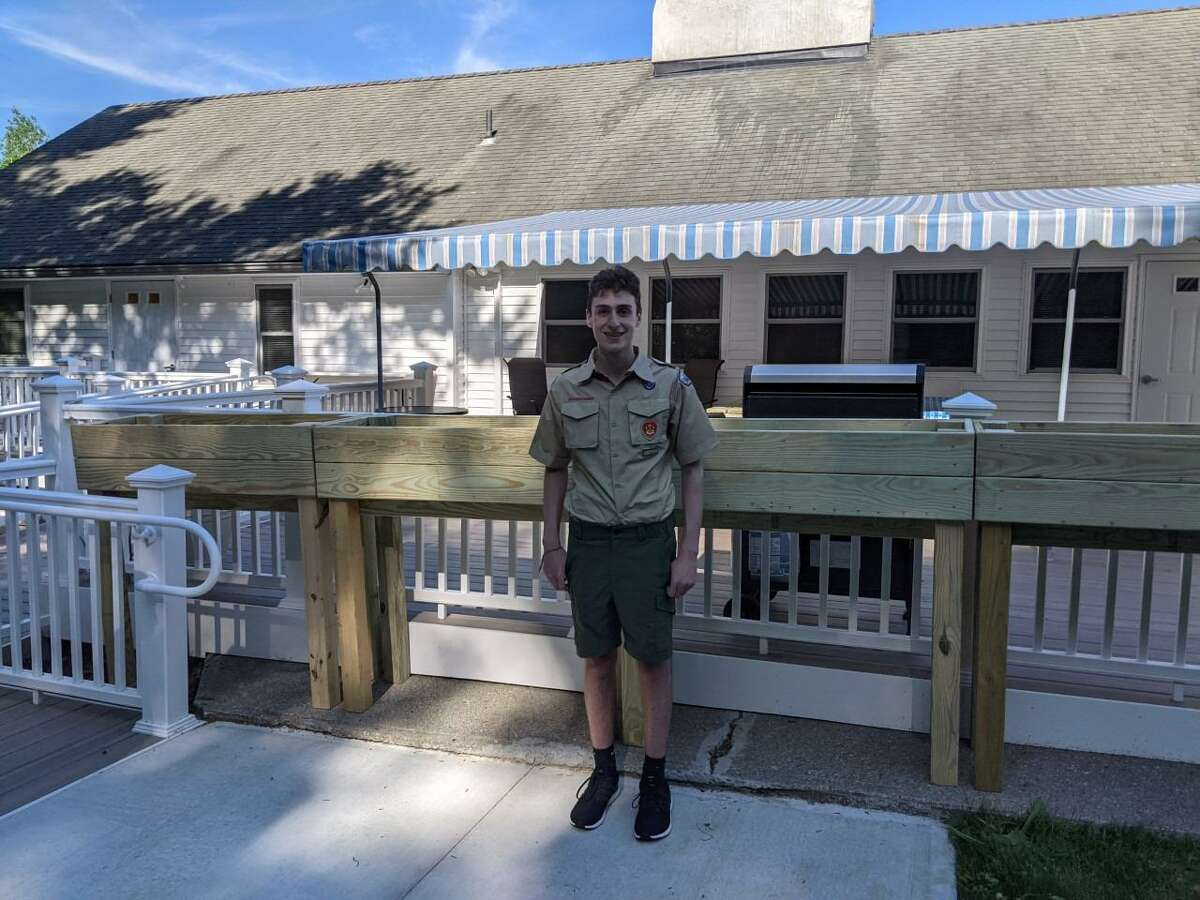 Ben SanServino, who is a Danbury resident, stands with four raised planters he recently made for the residents of the Pound Sweet Hill group home in Bethel, which is run by the nonprofit organization Ability Beyond. SanSeverino also recently built, and installed two accessible picnic tables for the residents.
