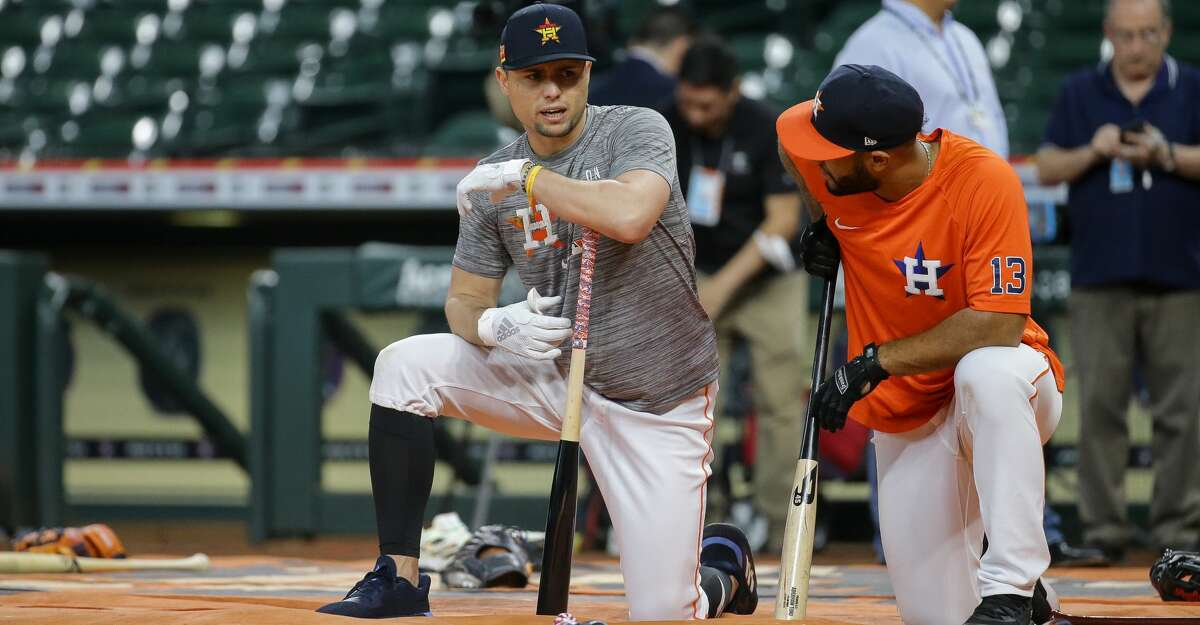Houston Astros infielder Aledmys Diaz (16) talks with third baseman Abraham Toro (13) during batting practice, before an MLB game against the New York Yankees at Minute Maid Park on Friday, July 9, 2021, in Houston.