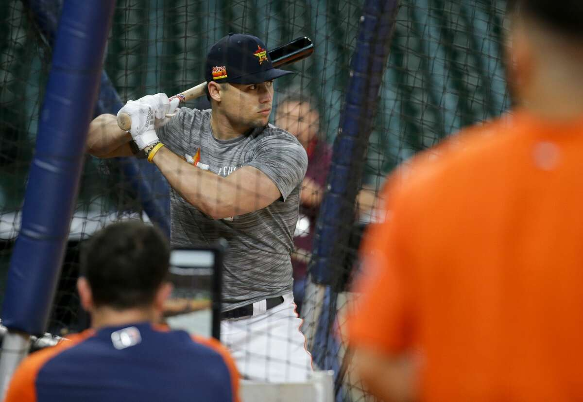 Houston Astros infielder Aledmys Diaz (16) participates in batting practice before an MLB game against the New York Yankees at Minute Maid Park on Friday, July 9, 2021, in Houston.