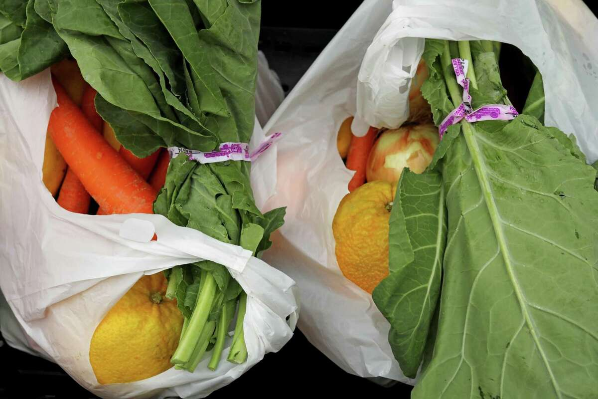 Produce is plentiful in bags of groceries provided at the Alameda County Community Food Bank distribution center in Oakland.