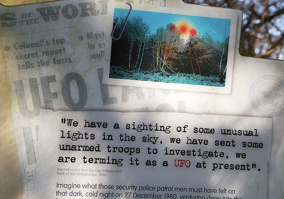 Newspaper headlines report on numerous sightings of an unidentified flying object.